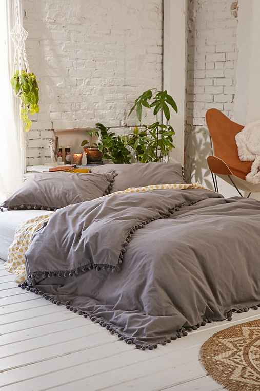 Magical thinking pom fringe duvet cover urban outfitters Magical thinking bedding