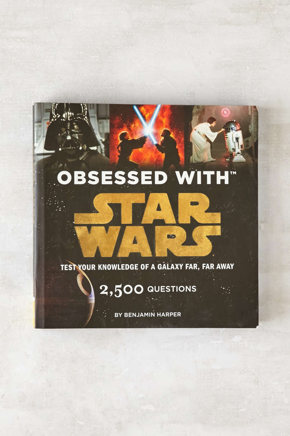 Obsessed with Starwars?  Get your guy this book that has 2500 trivia questions!