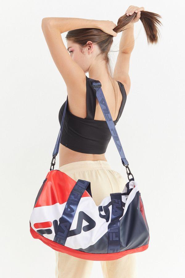 559834f0993ff7 Fila Major Striped Duffle Bag Urban Outfitters | 2019 trends | xoosha