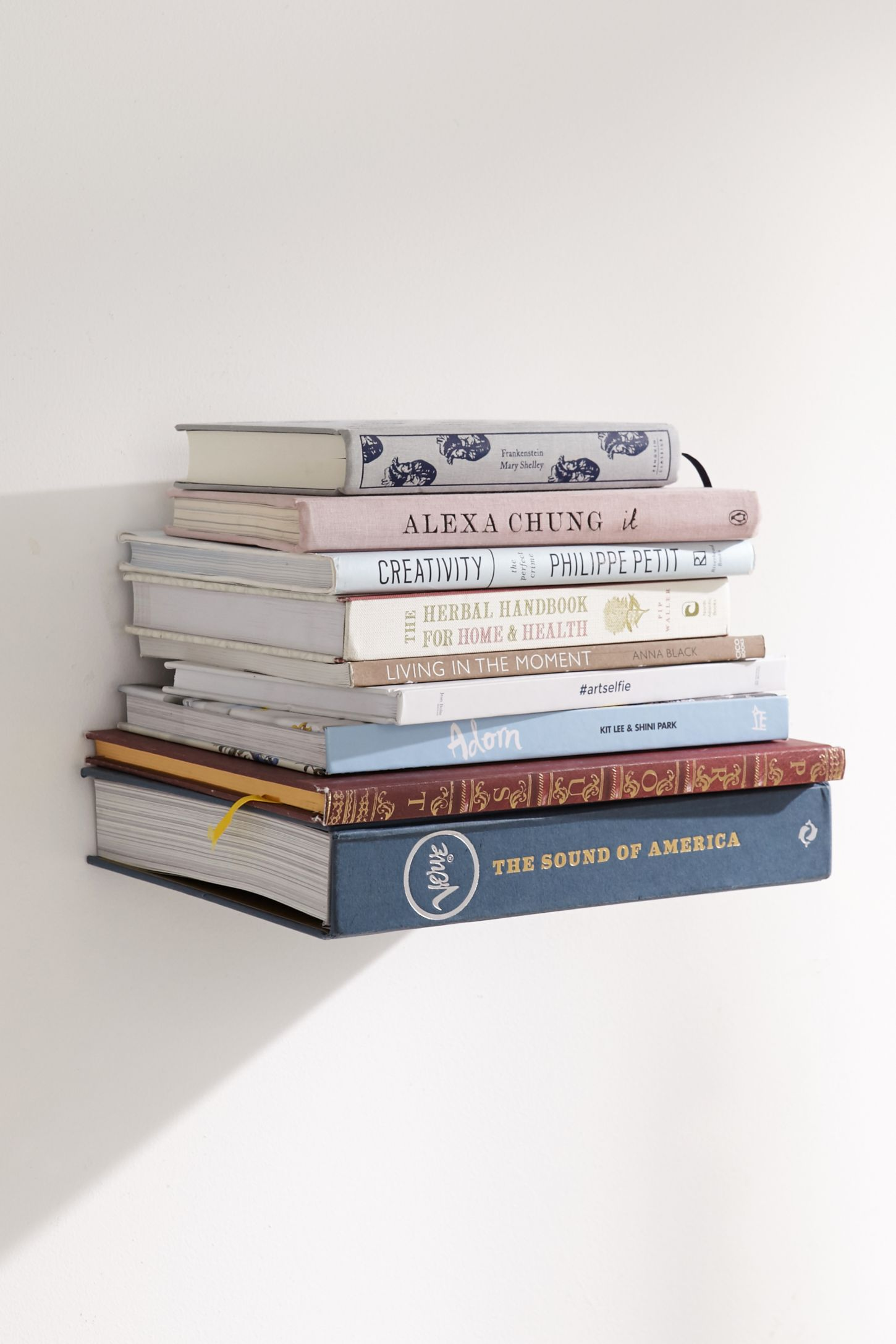 invisible book shelf urban outfitters