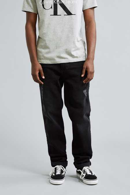 Calvin Klein X UO Destructed Anti-Fit Black Jean