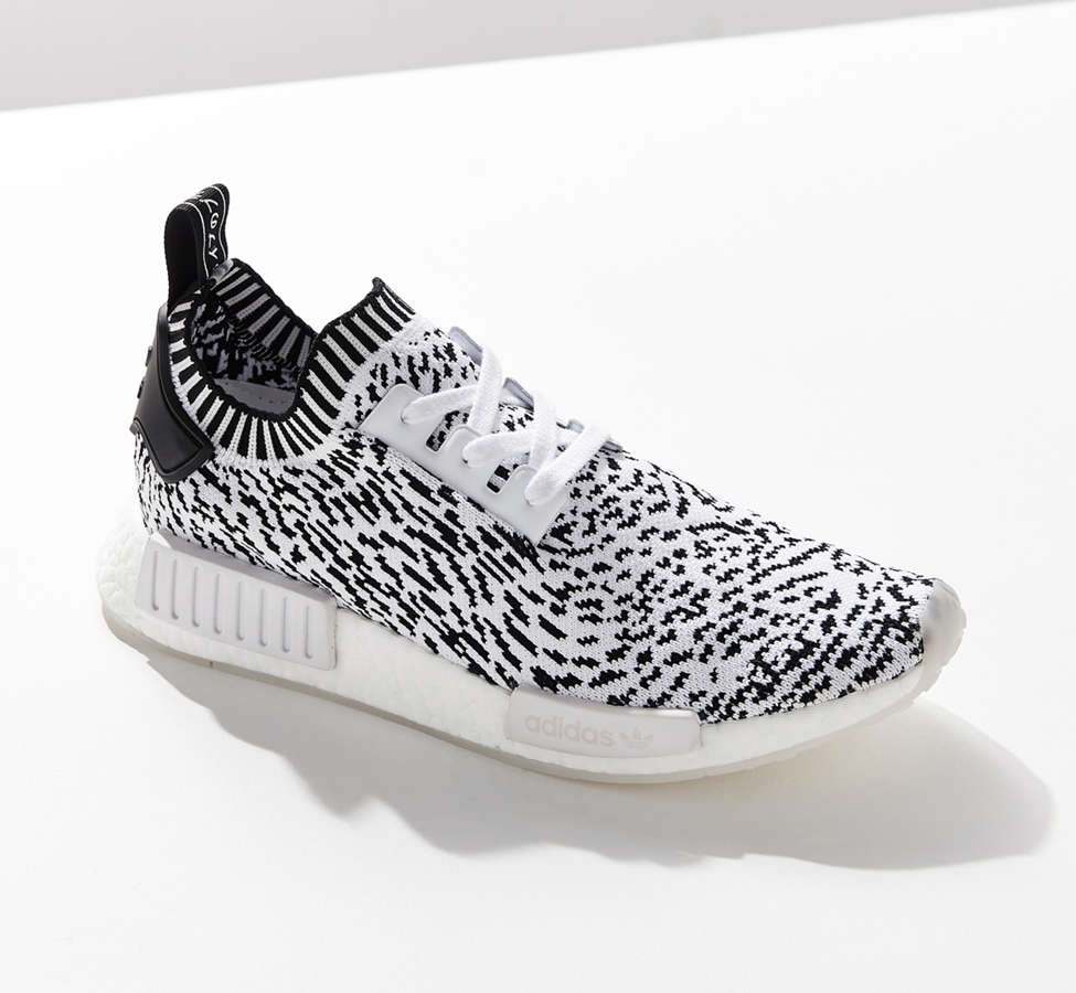 Slide View: 1: adidas NMD R1 Primeknit Core Graphic Sneaker