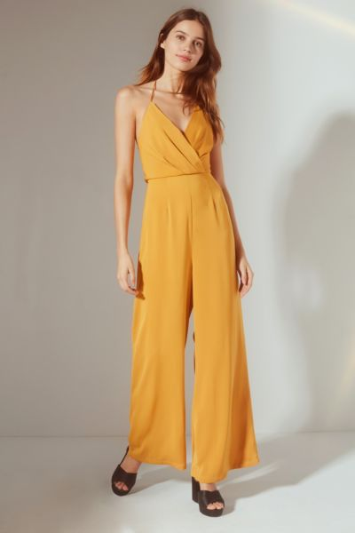 UO Halter Surplice Jumpsuit - Mustard 0 at Urban Outfitters