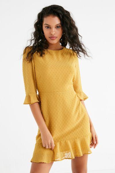 UO Swiss Dot Ruffle Hem Mini Dress - Mustard 0 at Urban Outfitters
