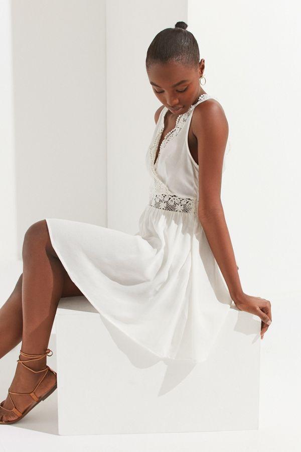 0d0b3d0ee647 Slide View  1  UO Lace-Trim Surplice Mini Dress