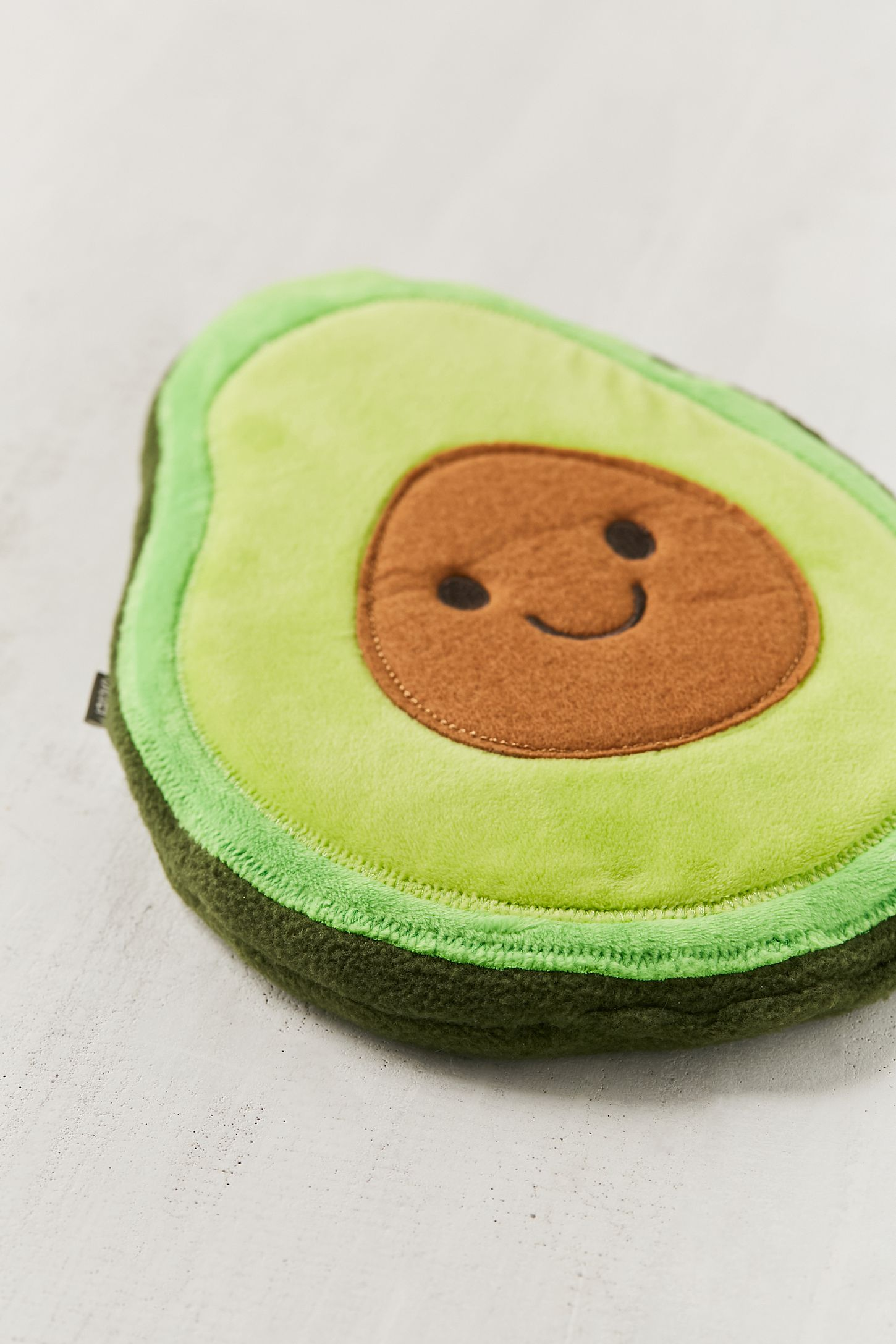 huggable avocado cooling heating pad urban outfitters
