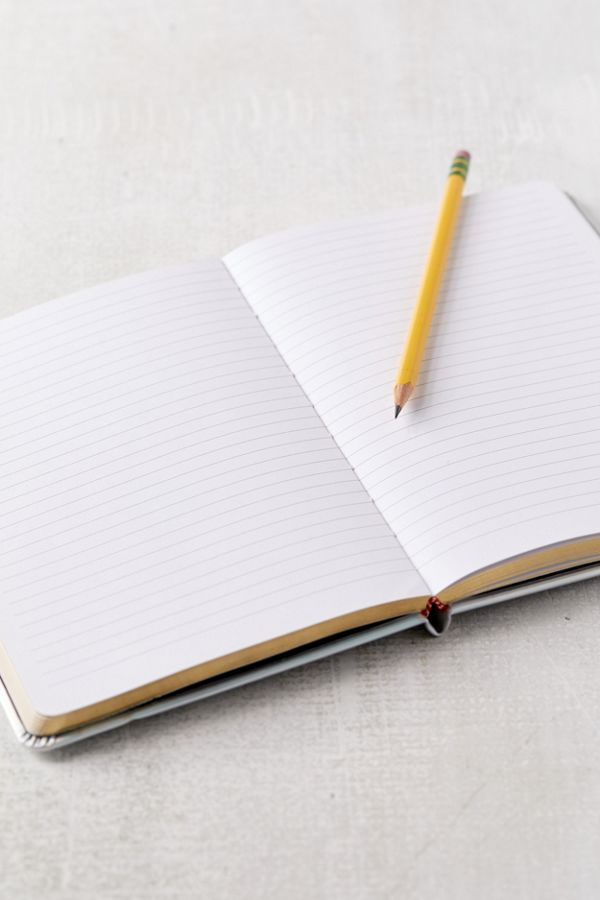 A notebook and a pencil on a table