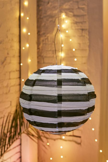 Lamps home lighting urban outfitters soji black white 14 striped round solar lantern mozeypictures Image collections