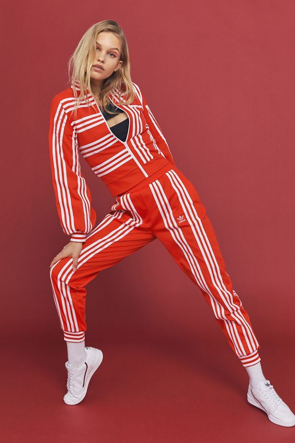 Exact Product: By Ji Won Choi 3-Stripe Jogger Pant, Brand: Adidas Originals, Available on: urbanoutfitters.com, Price: $120